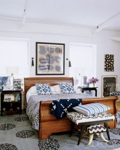 I was never into loads of patterns mixed together, but this bedroom pulls it off nicely. The simple and elegant color scheme helps.