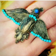 """Vintage 2 Finger Phoenix Ring-OBO use offer button standout from the crowd❗️Fierce Vintage 2 Finger Phoenix Ring. Highly sought after, rare ring, turquoise color glass cabochons with azure blue rhinestone eye. Beautiful & unique, this vintage piece can be worn on any two fingers you desire. The metal has darker patina in areas. You may choose to clean with polish. It is currently in its fashionable vintage state. Measures approximately 2.6x2.5"""". Vintage Jewelry Rings"""