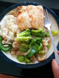 Steamed fish with stir fry veggies and rice