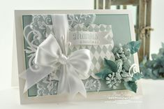 love the stamped background on the spellbinders label, the lace, the bitty flowers - delicious card!