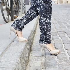 Step out in style. A classic pair of nude heels paired with a loose jumpsuit is our secret to summer in the city style. #kcstyle