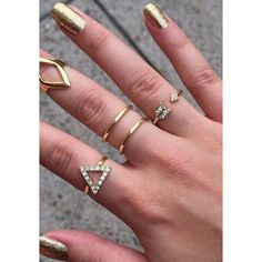 If you want to create a boho look without being too Bohemian, then this gold geometric rhinestone ring set ought to do the trick. Shop here.