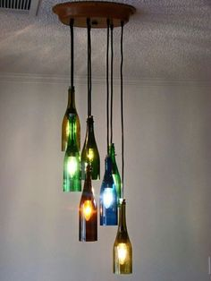 wine bottle chandelier (etsy) – No DIY & item unavailable but note ceiling plate & arrangement Read Full Article Here by luishsoni Wine Bottle Art, Lighted Wine Bottles, Bottle Lights, Wine Bottle Crafts, Beer Bottles, Glass Bottle, Wine Bottle Chandelier, Diy Chandelier, Halloween Chandelier