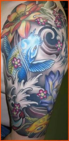 Single blue koi fish with white waves and various types of flowers