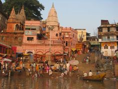 India. Dawn in Varanasi lights up the bathers and worshipers along the storied Ghats.
