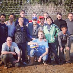 YPT's Rowan poses with the players after mixed volleyball games at the Mt Chilbo Homestay, North Hamgyong, North Korea.