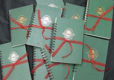 Create journals to take notes using vintage book covers and wire binding