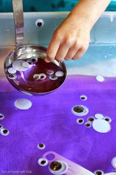 "Colored Water Sensory Bin: Googly Eye Soup from Fun at Home with Kids- could be a fun activity near halloween as ""monster eye soup"""