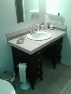 an old desk that i stripped and refinished i repurposed it into a bathroom vanity