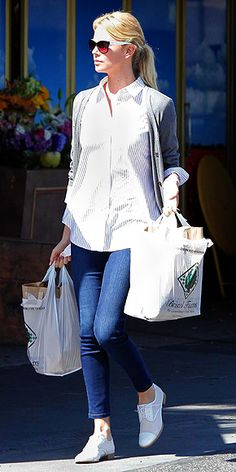 Charlize Theron - grey cardi, striped button-up, jeans, white lace-up oxfords