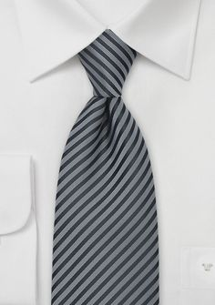 Elegant Gray and Charcoal Tie - Puccini added a new color to one of their best selling collections. This narrow striped tie pairs the colors charcoal and silver. It is a tie t Cheap Neckties, Black Suit Men, Der Gentleman, Silver Tie, Black Leather Dresses, Grey Tie, Pinstripe Suit, Mens Silk Ties, Skinny Ties