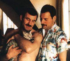 Freddie Mercury, Jim Hutton, and their cat.