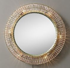 RH TEEN's Illuminated Crystal Large Round Mirror:Replete with hundreds of reflective crystals in a simple metal frame, this illuminated mirror serves as a stunning statement piece.