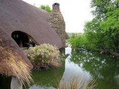 Thatched roof on the water Found photo through Babbles 25 Storybook Cottages Post: http://blogs.babble.com/family-style/2011/08/09/living-in-a-fairytale-the-worlds-25-most-magical-storybook-cottage-homes/?pid=2862#slideshow