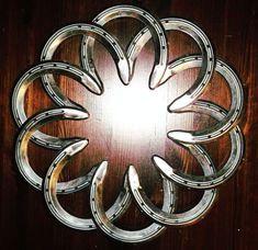 Horseshoe Flower by OtisIronwork on Etsy. Maybe this would produce some more good luck!