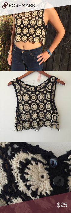 Free People Crochet Crop Top Super adorable black and cream crochet crop top. Two bottoms in the back. One small not noticeable stain in the back (pic). I am wearing a bandeau underneath (not included). Free People Tops Crop Tops