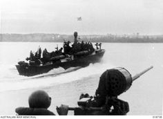 Seria, British North Borneo. 28 June 1945. A P.T. boat patrol out from Brunei Bay on a twenty-two hour patrol during Allied invasion operations. These boats are capable of high speed. P.T. 82 was ...