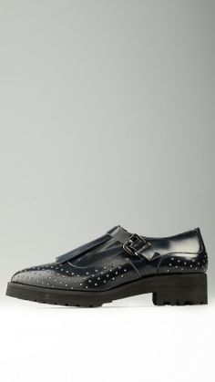 Blue polished leather buckled shoes
