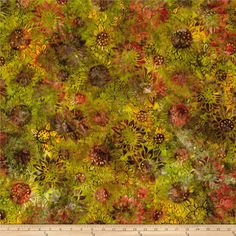 Kaufman Artisan Batiks Cornucopia Sunflowers Harvest from @fabricdotcom  From Robert Kaufman, this batik print cotton fabric is perfect for quilting, apparel, and home decor accents. Fabric features an allover design of sunflowers. Colors include yellow, purple, brown, rust, and green.
