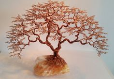 Arbre de vie en cuivre émaillé sur sur calcite orange