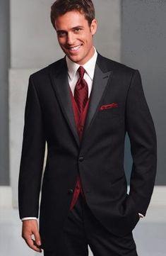 Black tux with burgundy tie by Freeman
