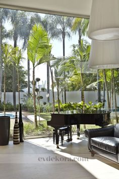 Tropics, light filled room and a grand piano!
