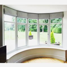5 cascade roman blinds in a curved bay window. 5 cascade roman blinds in a curved bay window. Bay Window Shutters, Bay Window Curtains, Curtains With Blinds, Blinds For Windows Living Rooms, Living Room Roman Blinds, Blinds For Bay Windows, Grey Roman Blinds, Bow Windows, Blinds Design