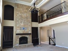 The stone fireplace in our custom home project in Marshall Township is coming along.