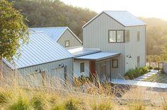 Exterior paint: Sage Mountain, Benjamin Moore (gabled structure); Winterwood, Benjamin Moore (flat-roof structure)
