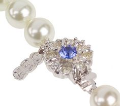 Emulate the elegance of a true style icon with this classic strand. Page 1 QVC.com