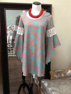 Bright mint dress with coral design and lace insert sleeves!
