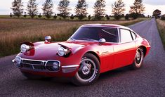 The '67 Toyota 2000GT. Maybe too many headlights, but still gorgeous.