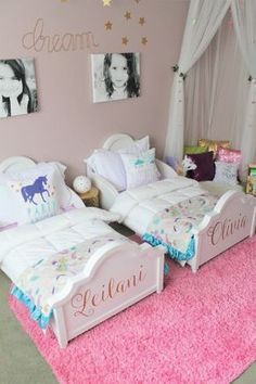 Double the big-kid beds, double the fun! This dreamy toddler room inspiration will make your little ones excited to share a room with their sibling. The key to creating a fun and functional kids' room for two siblings is to give them each their own space. We love the idea of adding their names to the ends of their big-girl beds. This enchanting little girls' room design is sure to make your own child feel like a princess! #kidsroomideasshared