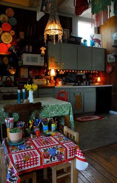 http://dishfunctionaldesigns.blogspot.com/2013/01/the-bohemian-kitchen.html. Lights.