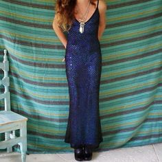 A personal favorite from my Etsy shop https://www.etsy.com/listing/204609853/1990s-black-iridescent-blue-mermaid-maxi