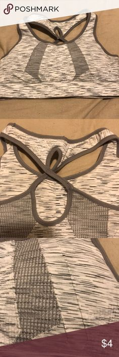 Sport bra This beautiful black and white marble looking sport bra is actually VERY impressive compared to many other sport bras. This sport bra keeps everything held in and has a really pretty design Other