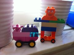 Robot Menta and a car built with Duplo.