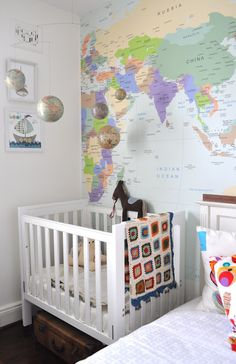 He already has the world map above his bed and the solar system on the ceiling but love the wallpaper and the mobile!