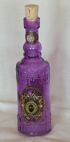 Cylindrical purple glass bottle