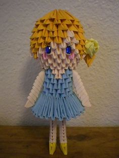 3D Origami doll with light blue dress
