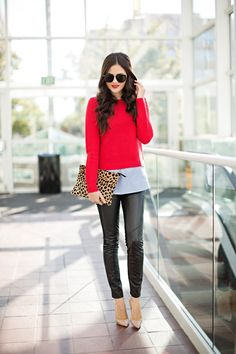 red sweater over long shirt, leather pants, leopard bag, nude shoes
