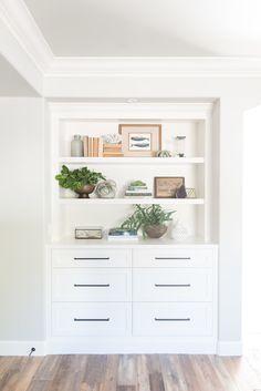 PURE SALT INTERIORS // TALEGA BEACH HOUSE PROJECT // MASTER BEDROOM // custom built-in, wood floors, black hardware, potted plant, vintage books, styling, shelves..