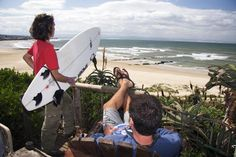 Surfers checking out waves, South Africa