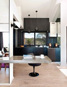 Love this cantilevered concrete desk