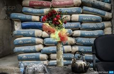 A shell is used as a vase in the Syrian border town of Kobane/Ain al-Arab, on January 28, 2015.