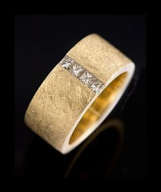 Handcrafted solid 10mm wide thick yellow gold rought matt finished band with four princess cut Champagne diamonds tension set in it
