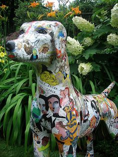 "J R Sitarski dog - collage on fiberglass - 48"" long x 35"" high"