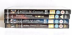 Pirates of the Caribbean DVDs 1 2 and 3 PLUS The Curse of the Black Pearl Lost Disc. Pirates of the Caribbean DVDs Pre owned and used. The boxes are in good condition. The discs are in very good condition.