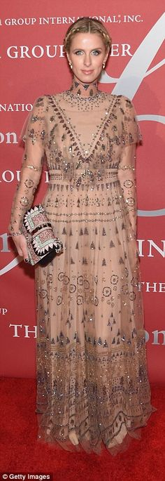 Rich: The floor-length sheer nude chiffon dress, delicately embroidered and bedazzled with sequins, cost more than $20k