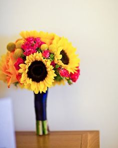 Since I was 7 I've said my wedding flower and theme would be sunflowers :)